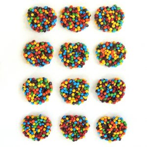 Buy 12 individually wrapped handmade Chocolate Covered Pretzels with Famous Chocolate Candy Coated Pieces for $32.50.
